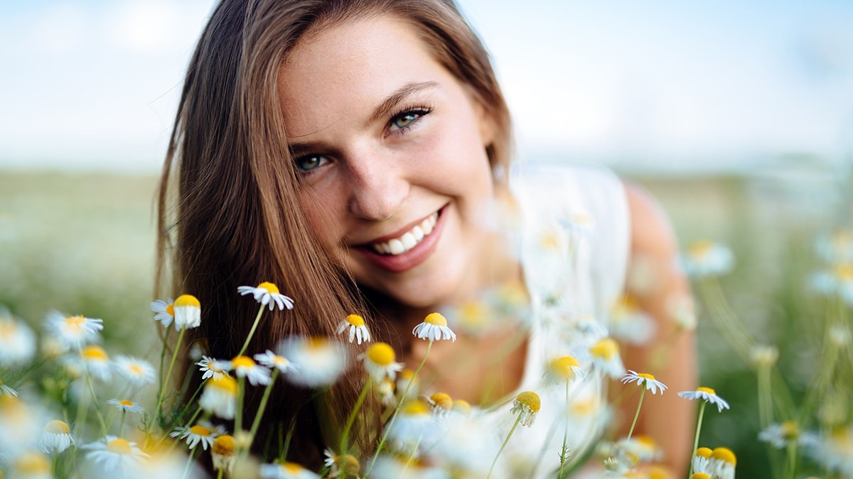 Woman with no allergies in field with flowers