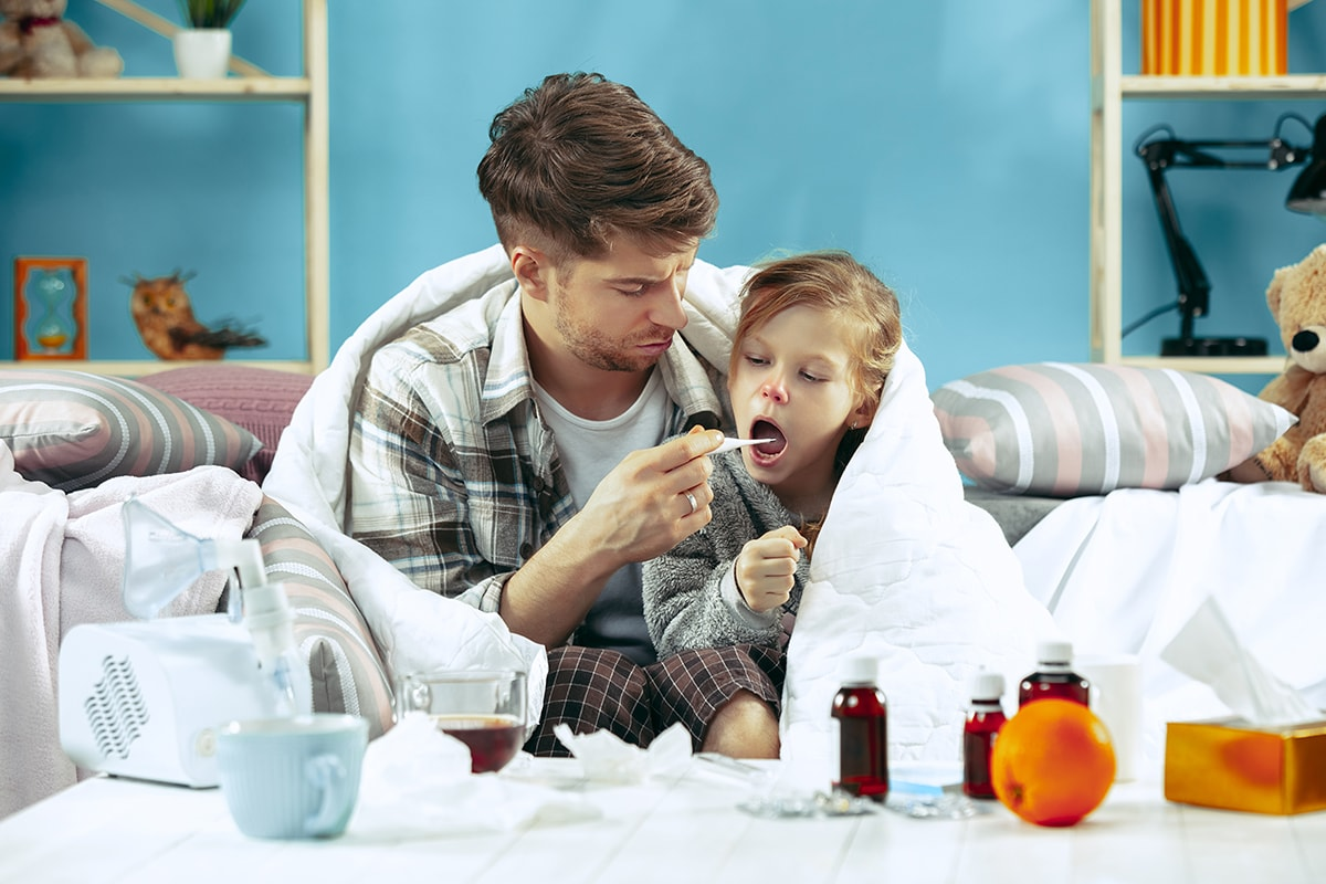 Sick child with father