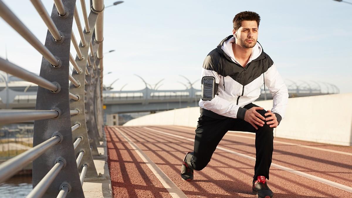 Man exercising despite chronic pain