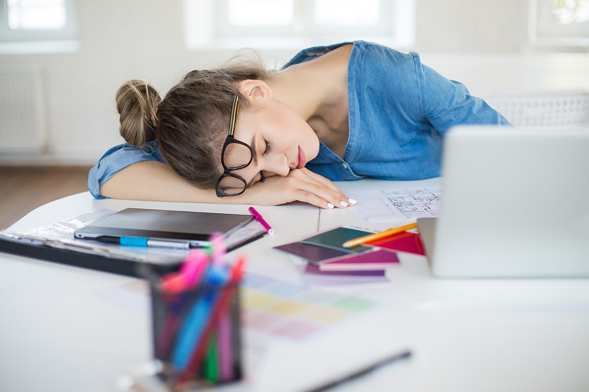 Tired woman sleeping at desk