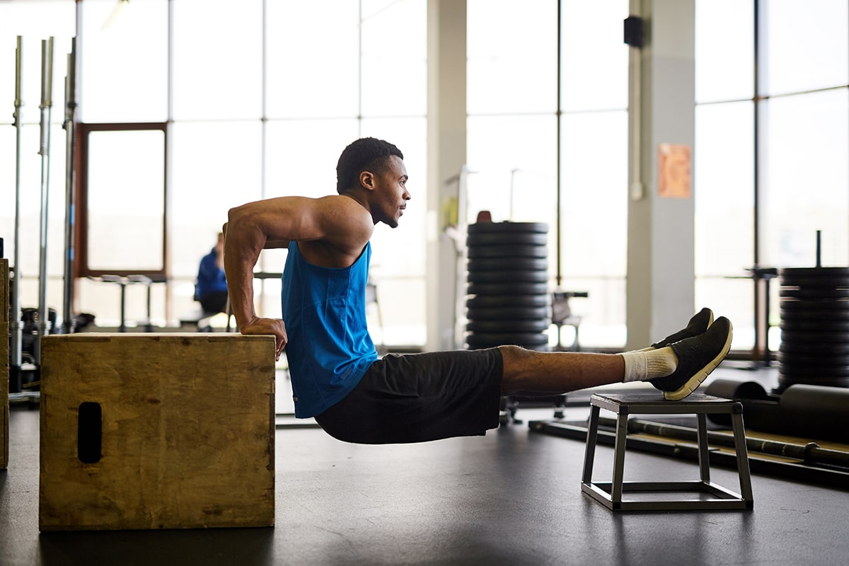 Man exercising doing dips